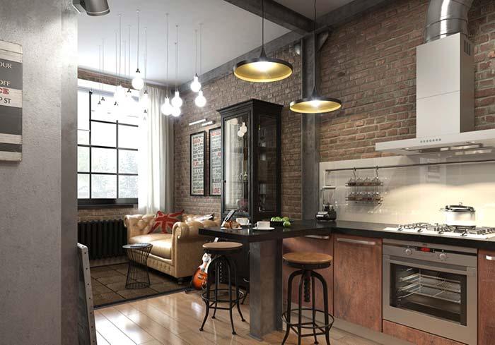 Cozinha com balcão em ambiente integrado no estilo industrial.