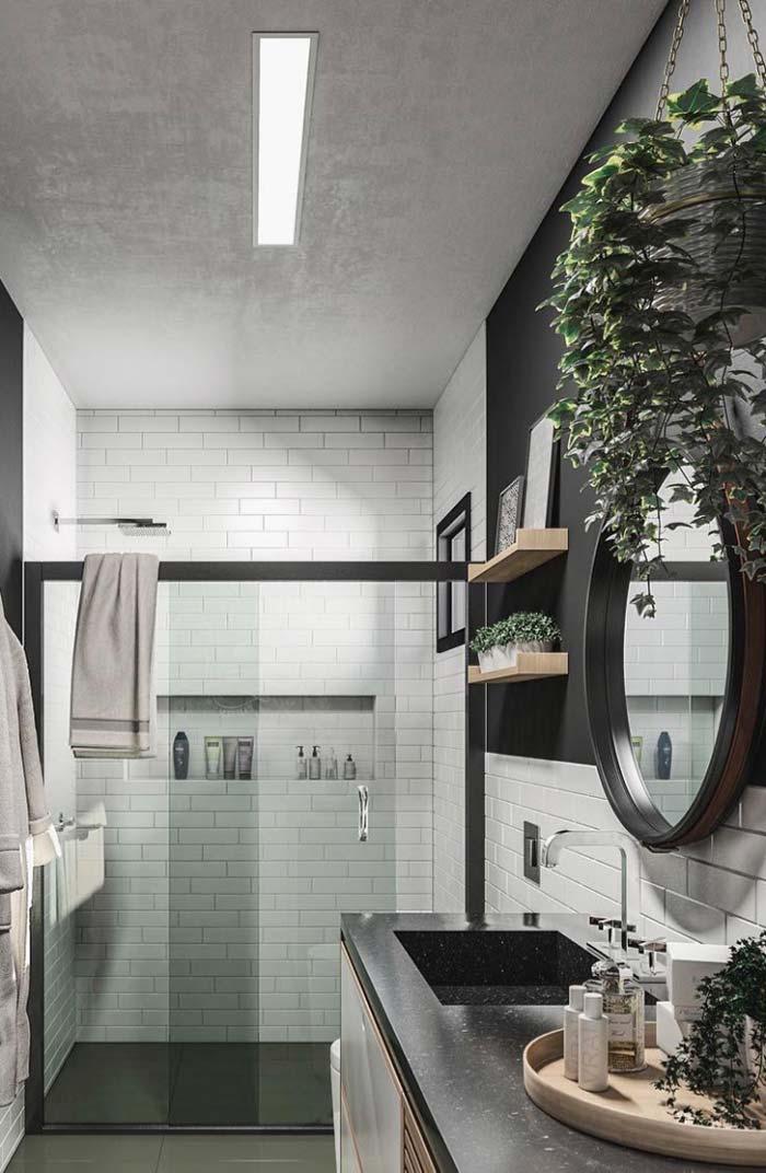 Banheiro preto e branco com cuba esculpida