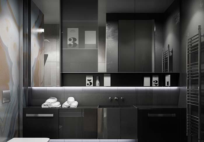 Banheiro preto e cinza com cuba esculpida