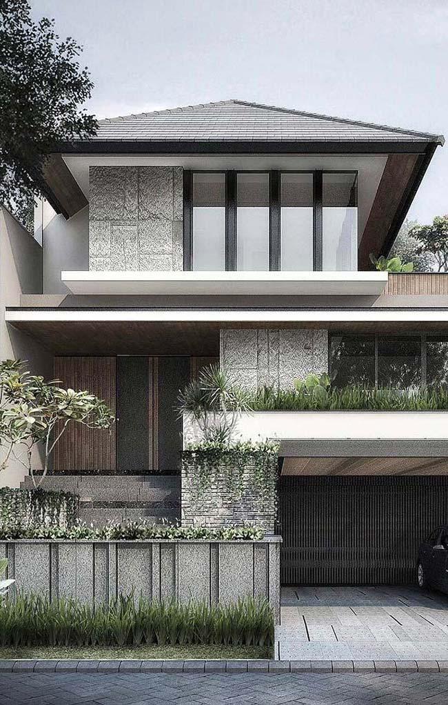 Casa moderna com telhado quatro águas