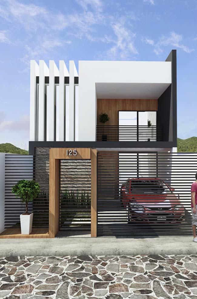 Casa planejada: fachada planejada de estilo moderna
