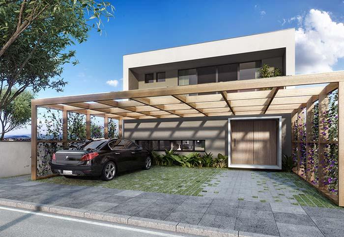 Casas planejadas: área da garagem foi coberta por um pergolado de madeira