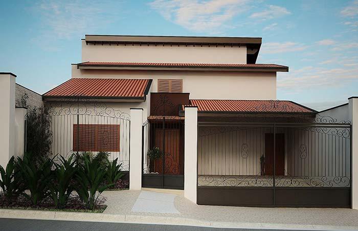 Casa planejada com portão de ferro