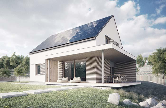 Planeje sua casa de modo sustentável; na imagem o telhado solar se destaca