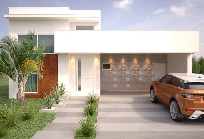 Fachada branca realça a arquitetura da casa