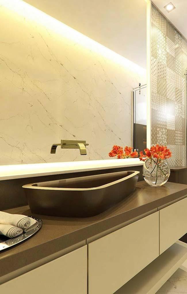 Design diferenciado para a pia esculpida em granito marrom absoluto