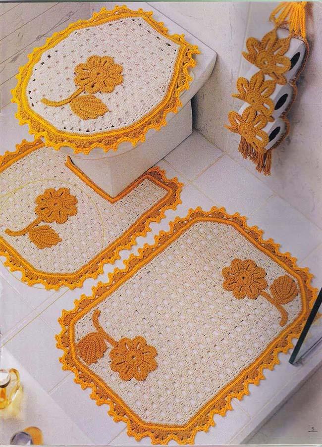 Jogo de banheiro de crochê com aplicação de flores
