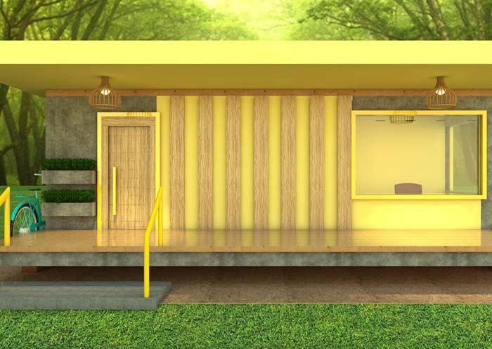 Fachada de casa pequena amarela