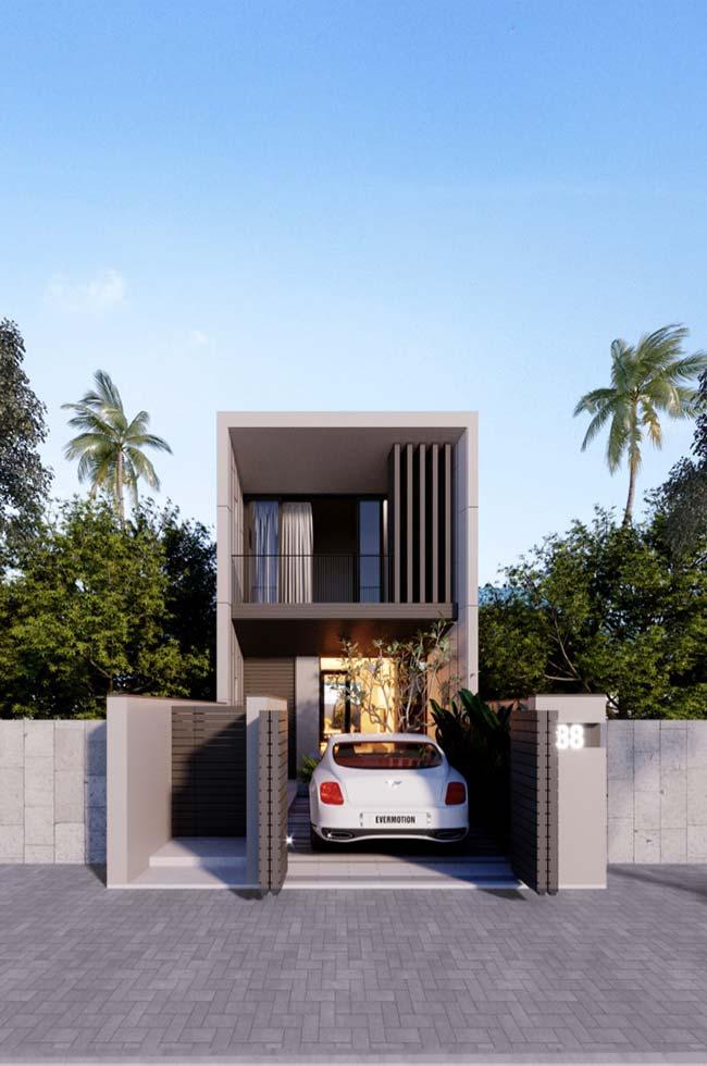 Casa pequena, moderna, com dois andares e garagem
