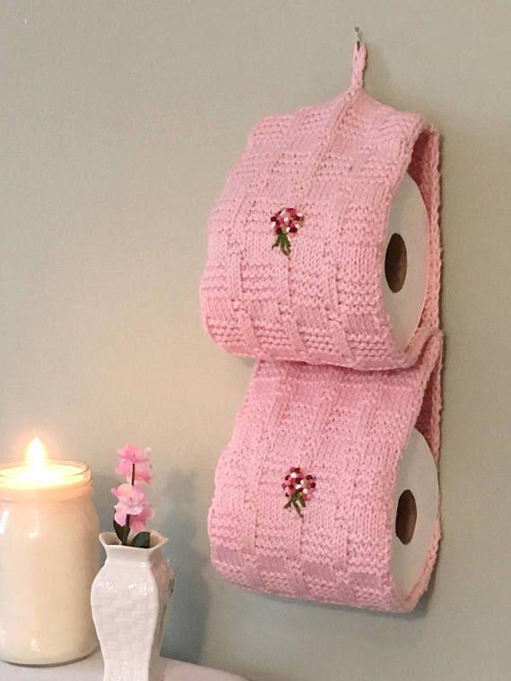 Porta papel higiênico em um tom de rosa delicado