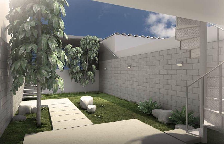 Jardim pequeno minimalista com pedras e árvores
