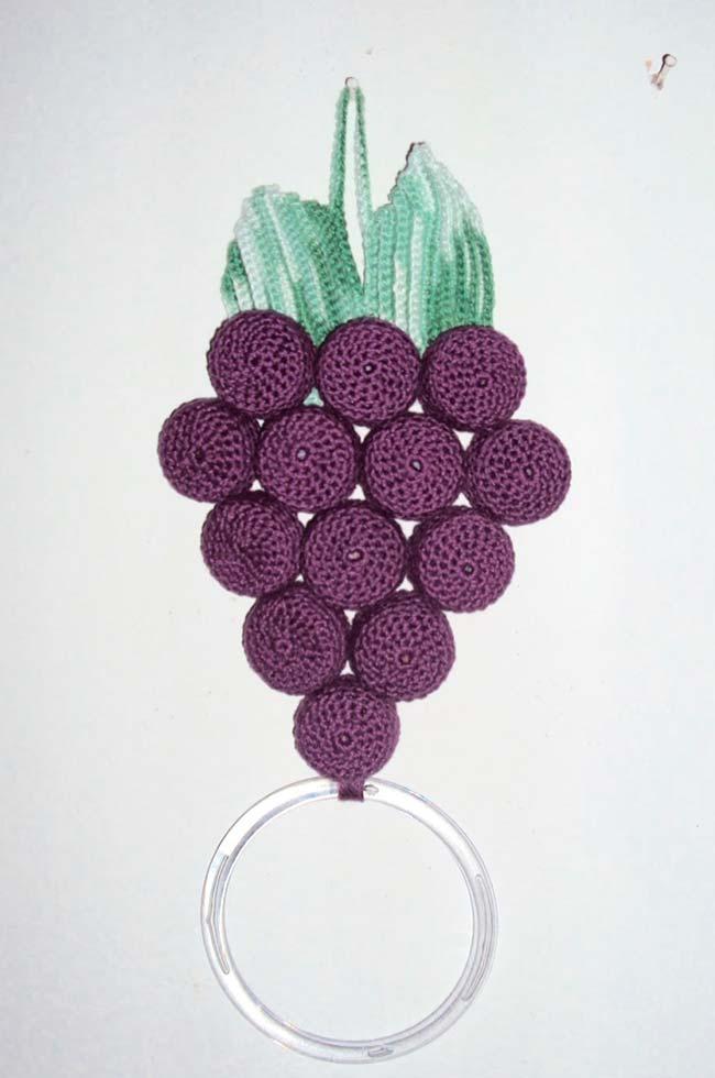 Cachinho de uvas como porta pano de prato