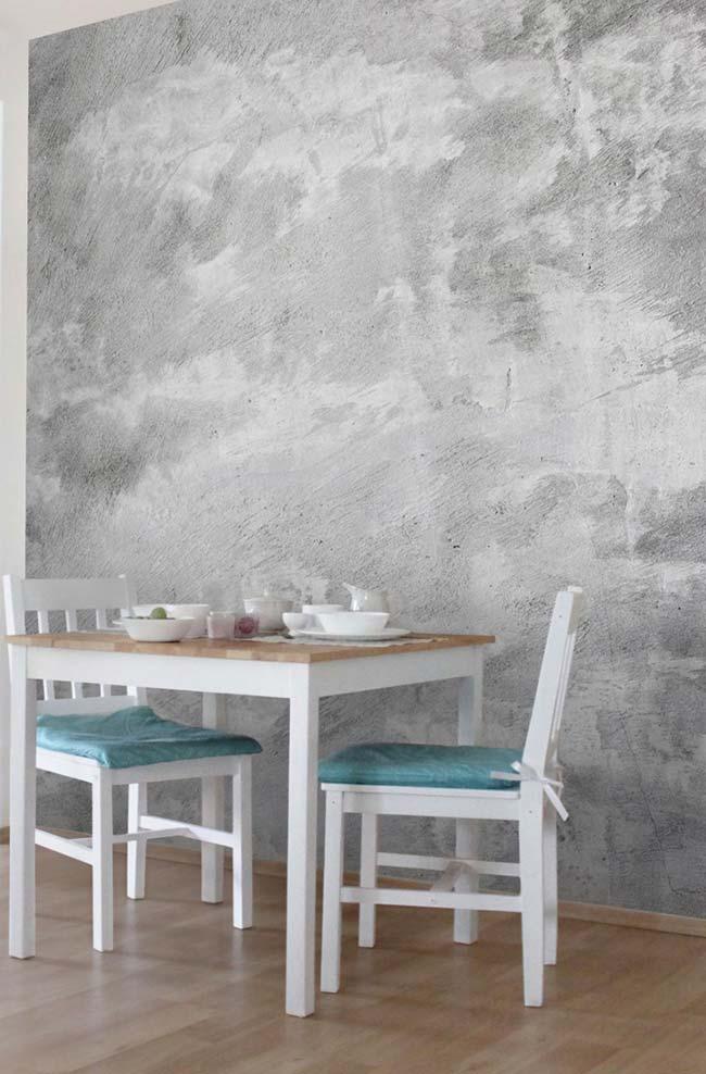 Sala de jantar com parede marmorizada cinza