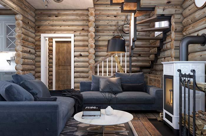 Decoração de sala rústica com toras de madeira