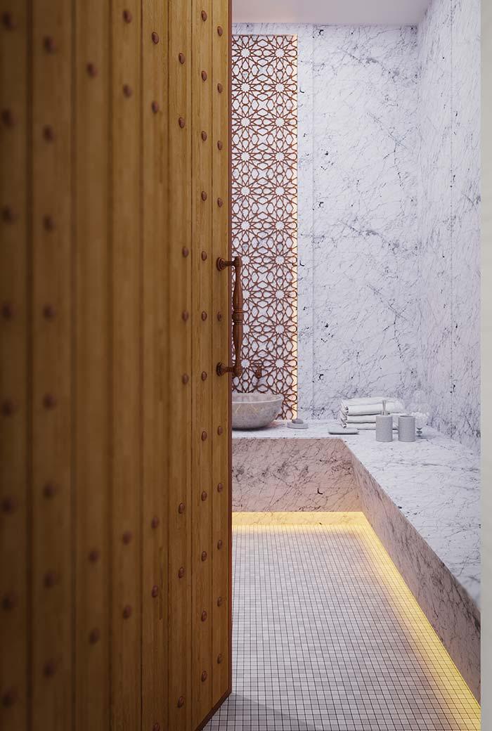 Um banheiro – enorme – todinho com mármore Carrara Gióia