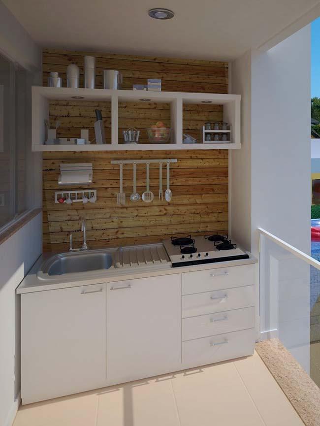 Varanda gourmet com nichos abertos e parede de pallet