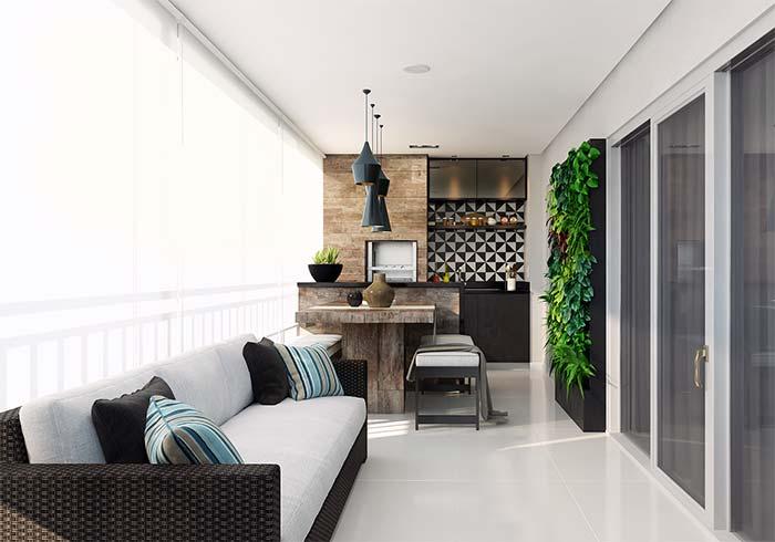 Varanda gourmet de apartamento com jardim vertical