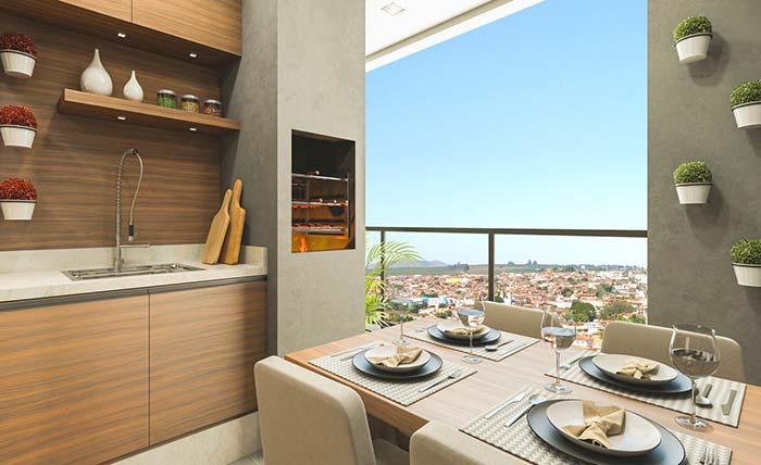 Varanda gourmet pequena de apartamento com pia, churrasqueira e mesa