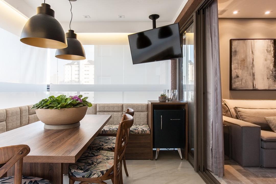 Varanda gourmet integrada a sala de estar