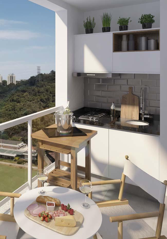Varanda gourmet com móveis planejados