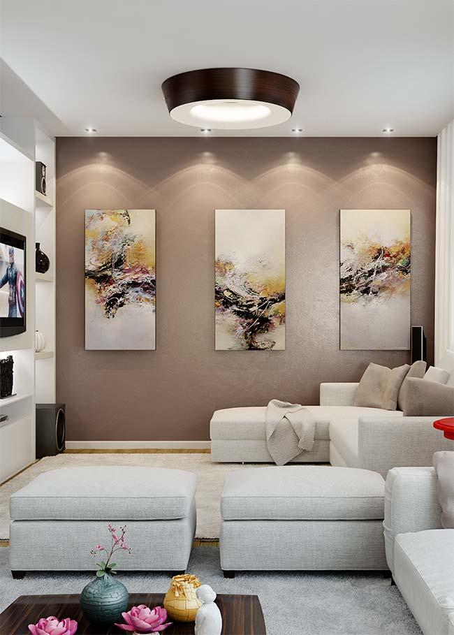 Obra de arte separada em 3 peças de quadros na parede