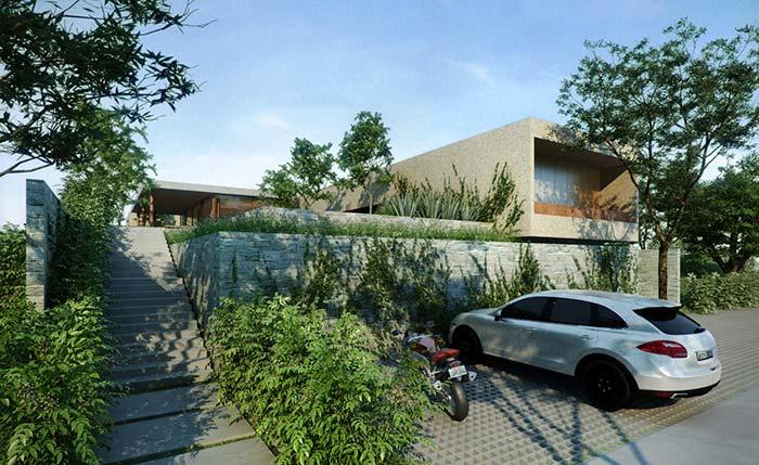 Essa casa conta com um cinturão verde, além do muro de arrimo
