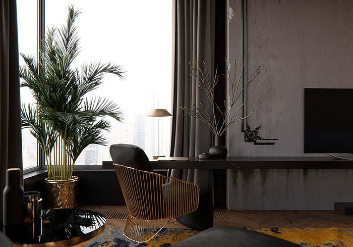 Mas se a intenção for criar um ambiente mais sóbrio e formal, invista em um vaso metálico, como esse da imagem