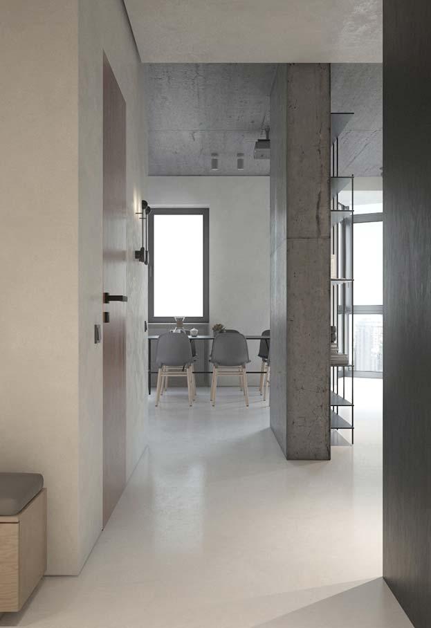 Nessa casa, o cimento queimado branco vai do piso, enquanto o de cor natural vai em apenas algumas paredes