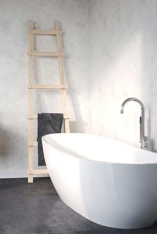 Nesse banheiro, o cimento queimado dá o tom tanto no chão, quanto nas paredes