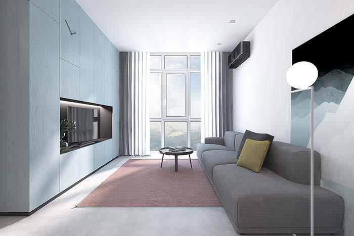 Cimento queimado branco faz uma composição harmônica com os tons neutros dessa sala