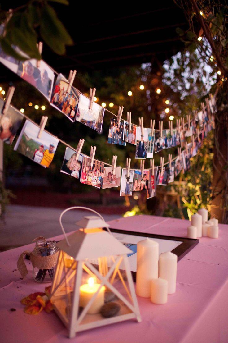 Ideia de decoração para festa de noivado simples: varal de fotos sobre a mesa