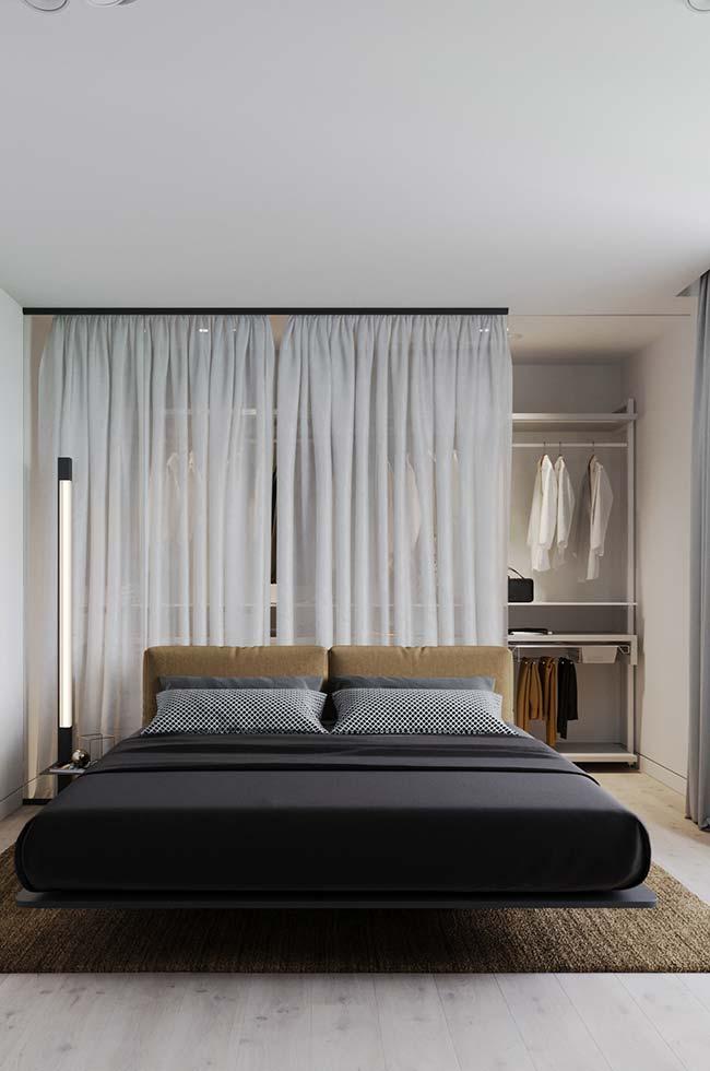 Quarto com closet e decoração moderna