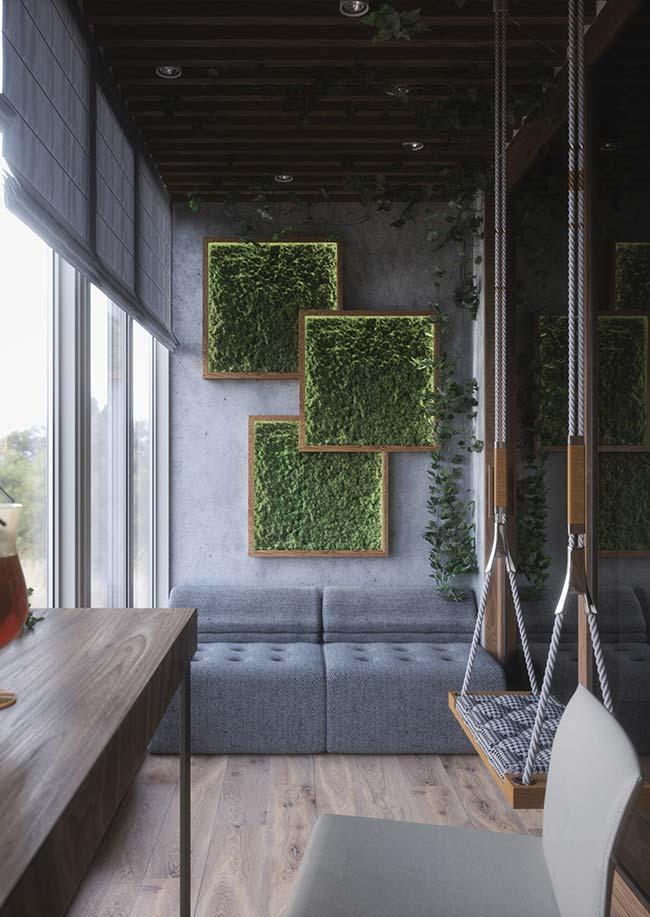 Varanda com decoração moderna e jardim vertical