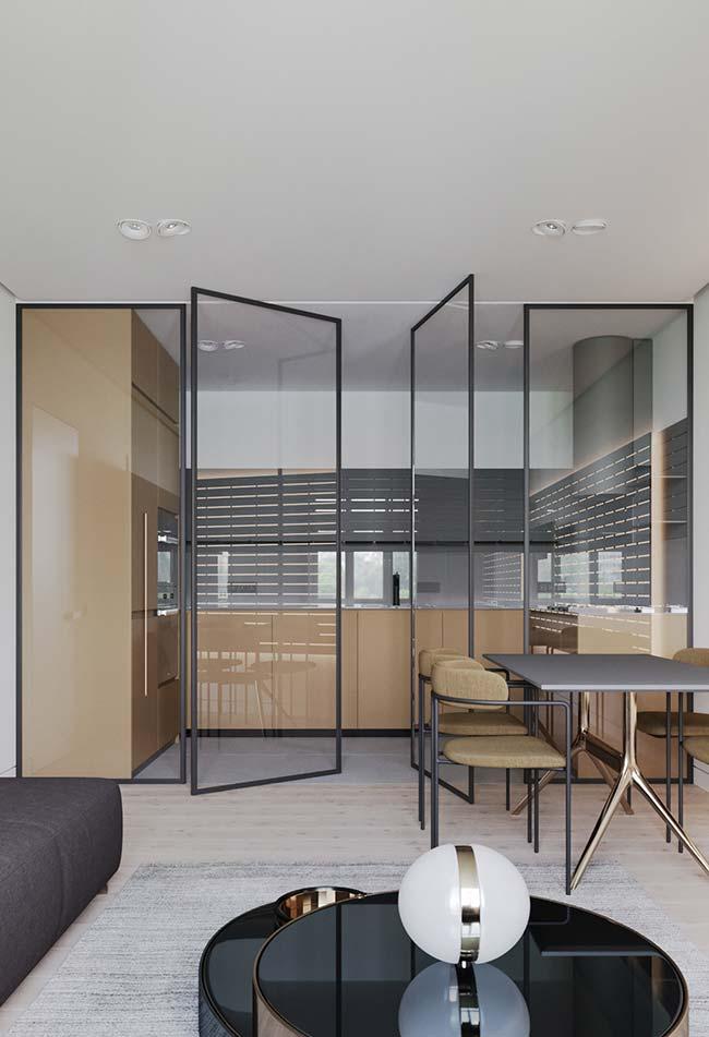 Porta de vidro que separa ambientes com decoração moderna