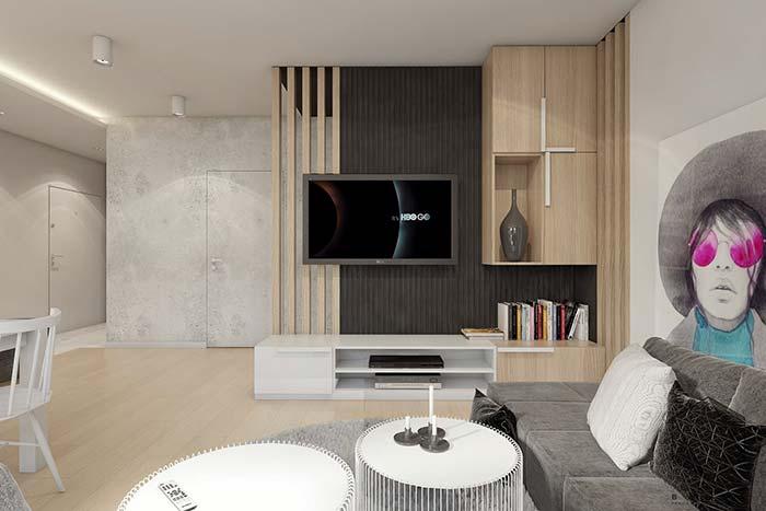 O painel dessa sala traz cor e realça a característica da decoração moderna