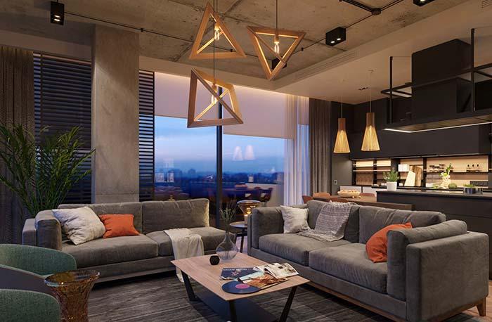 A sala de estar decorada aconchegante e confortável conta com teto e coluna revestidos com cimento queimado