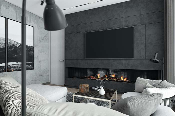 Sala de estar decorada em tons cinzentos e textura nas paredes