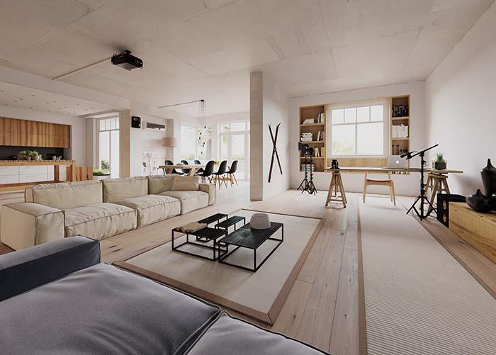 Ambientes integrados, entre eles a sala de estar, seguem a mesma paleta de cores e materiais