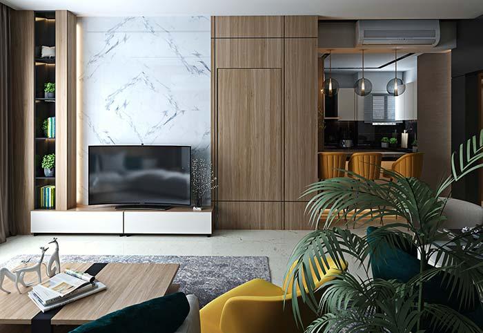 Elegância e requinte garantidos com o painel de mármore brancoda sala de estar decorada