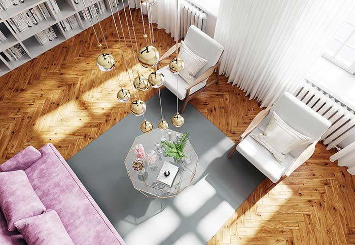 Uma disposição harmônica entre os móveis garante a funcionalidade e a beleza da sala de estar decorada