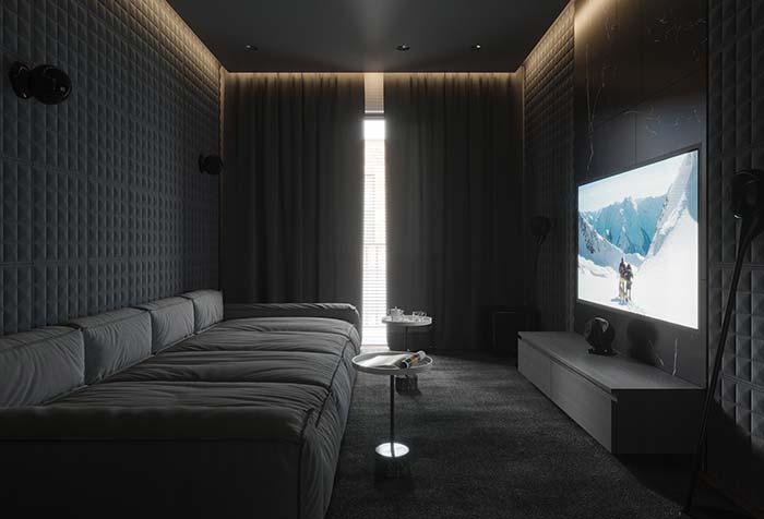 Sala de estar de apartamento decorado para quem ama cinema