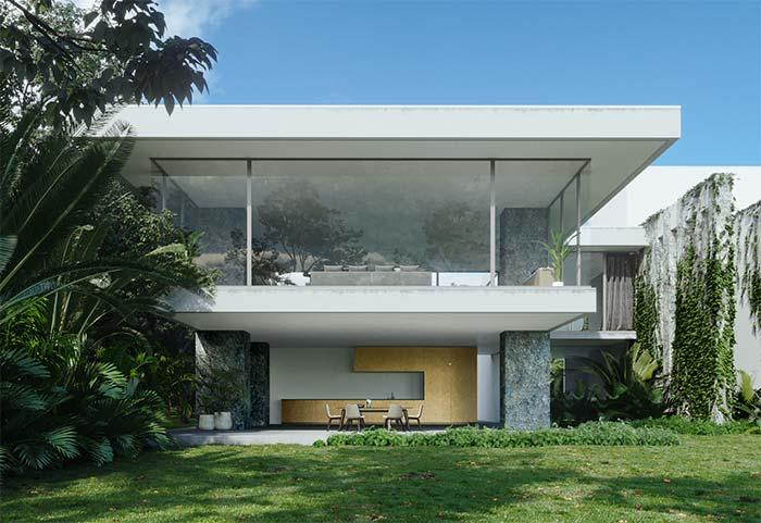 Nessa casa de arquitetura moderna, as pedras revestem os pilares estruturais da construção