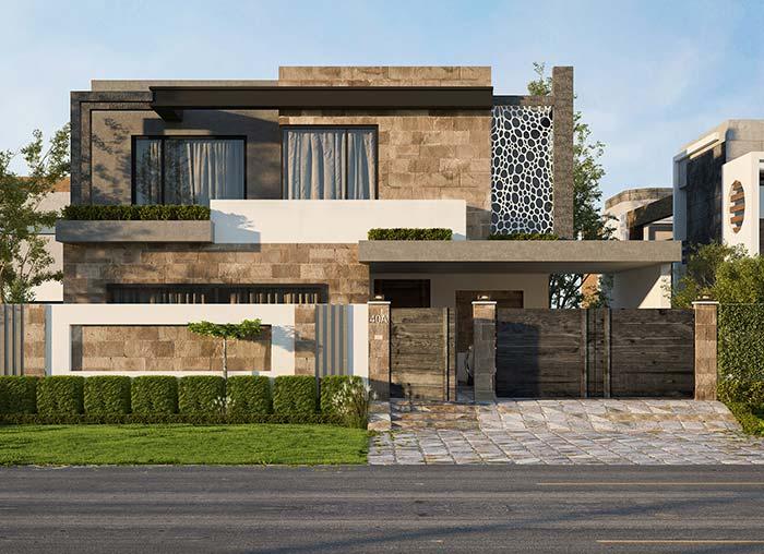 Quando o marrom não está nas pedras, ele vem na cor do portão e na pintura das paredes na fachada de casa com pedra