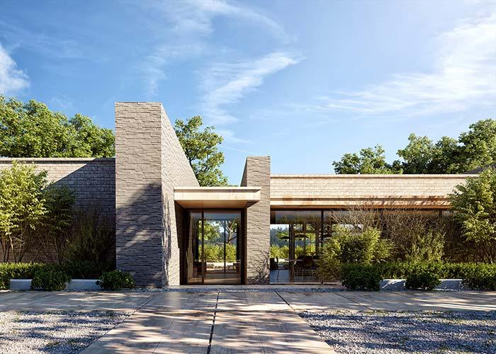 Uma das pedras mais comuns utilizadas nas construções brasileiras, a canjiquinha, foi a escolhida para a fachada dessa casa