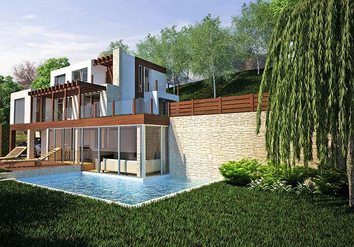 Junto a piscina e ao jardim, as pedras reforçam os elementos naturais presentes na fachada da casa com pedra