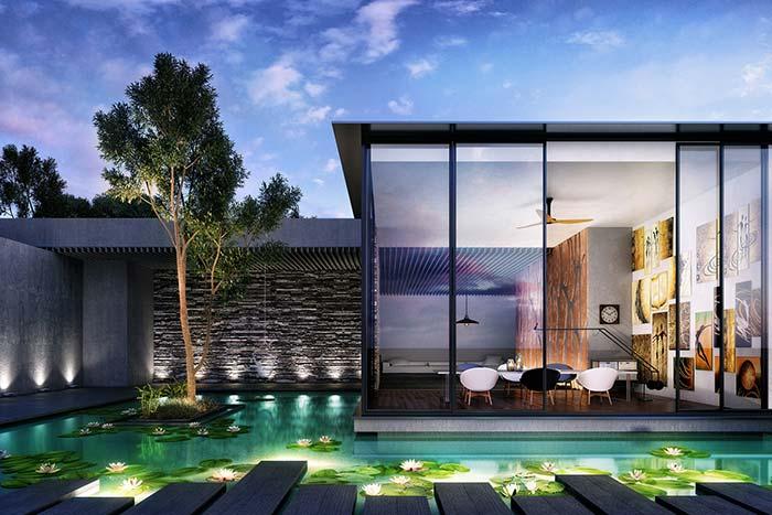 Fachada de casa com pedra: pedrinhas em filete revestem apenas a parede dos fundos junto à piscina