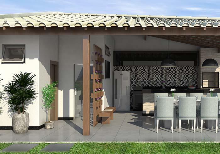 Edícula com espaço gourmet equipado com eletrodomésticos e um pequeno banheiro