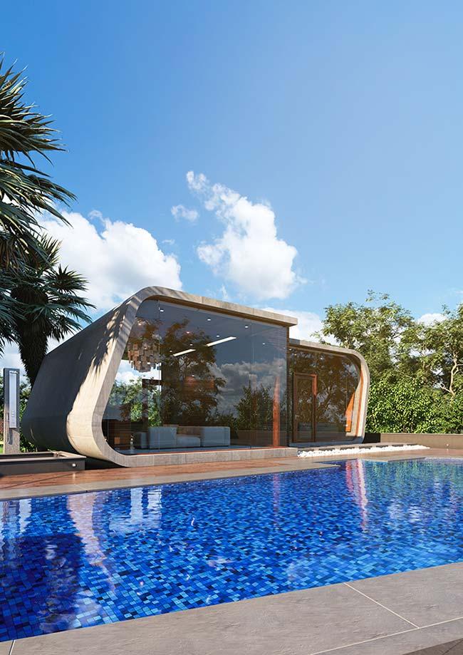 Edícula moderna de formas curvas e paredes de vidro foi construída junto à área da piscina