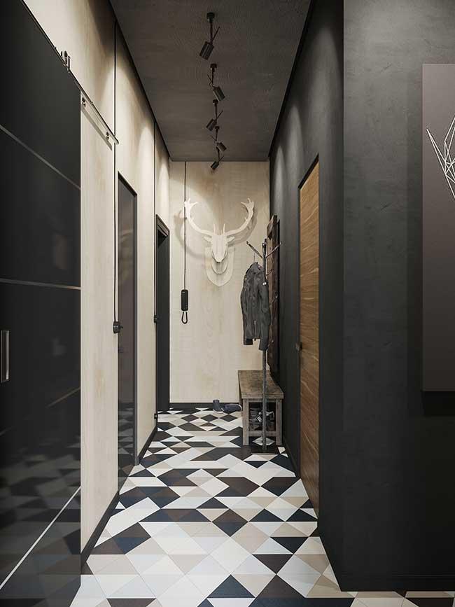 Spots no teto e piso de formas geométricas no chão: a união entre o moderno e o industrial está feita