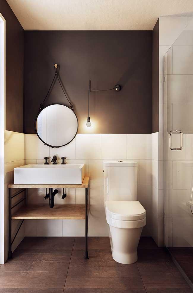 Nesse banheiro industrial, o destaque são os metais pretos combinando com a estrutura do gabinete
